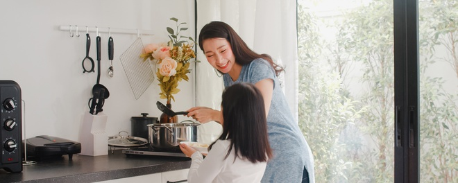 young_asian_japanese_mom_daughter_cooking_home_lifestyle_women_happy_making_pasta_spaghetti_together_breakfast_meal_modern_kitchen_house_morning
